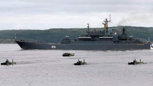 A Russian warship and amphibious military vehicles move during a naval parade rehearsal at the port of Severomorsk in the Barents sea