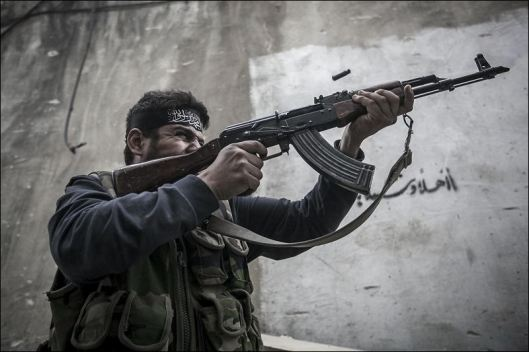 A-Free-Syrian-Army-fighter-shoots-his-gun